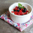 Healthy homemade crumbled cottage cheese with sour cream, honey, vanilla, fresh red and black currants, strawberry and mint leaves in a bowl for breakfast — Stock Photo