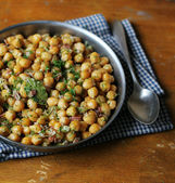 Homemade chickpea stew with smoked bacon, bay leaf, onion, garlic, dill and parsley in a pan for dinner — Stock Photo