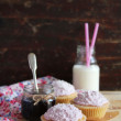 Cupcakes with berry marmalade and buttercream frosting on a wooden table — Stock Photo #45725887