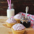Lemon cupcakes with homemade berry jam, cream cheese, coconut for Mother's Day dessert — Stock Photo #46064403