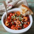 Mediterranean style roasted cherry tomatoes with shrimps, feta cheese and chopped parsley in a bowl for lunch or dinner — Stock Photo #46064419