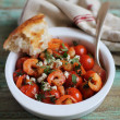 Mediterranean style roasted cherry tomatoes with shrimps, feta cheese and chopped parsley in a bowl for lunch or dinner — Stock Photo #46064423