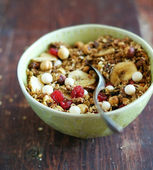 Healthy homemade granola or muesli with toasted oats, dried cherry, cranberry, figs, raisin, hazelnuts, cashew, walnuts, yogurt and white chocolate chips and honey in a bowl for breakfast or snack — Stock Photo