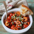 Mediterranean style roasted cherry tomatoes with shrimps, feta cheese and chopped parsley in a bowl for lunch or dinner — Stock Photo #46972809