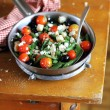 Salad with blanched green french beans, roasted cherry tomatoes, crumbled feta cheese, black olives, crispy wheat croutons in a pan, selective focus, mediterranean style — Stock Photo