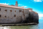 The ancient building with the tower in the Old Town, Budva, Montenegro, Adriatic sea — Stock Photo