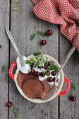 Chocolate pancakes with cherry berry and cream in a bowl for breakfast — Stock Photo