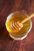 Honey with spoon — Stock Photo