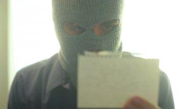 Criminal terrorist reading — Stock Video