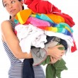 Young Woman Carrying a Pile of Washing — Stock Photo
