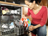 Woman Emptying / Filling Dishwasher — Stock Photo