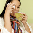 Stock Photo: Unwell WomDrinking Medicine