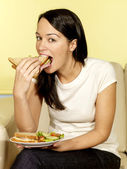 Young Woman Eating Sandwich — Stock Photo