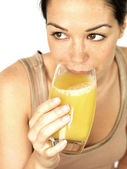 Young Woman Drinking Fruit Juice — Stock Photo