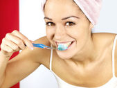 Young Woman Brushing Teeth — Stock Photo