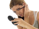 Young Woman Putting on Eye Liner — Stock Photo