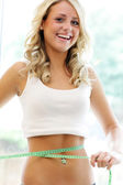 Attractive Slim Teenage Girl Measuring Waist — Stock Photo