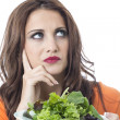 Stock Photo: Attractive Young WomEating Green Leafed Salad
