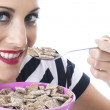 Attractive Young Woman Eating Breakfast Cereal — Stock Photo