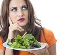 Attractive Young Woman Eating Green Leafed Salad — Stock Photo