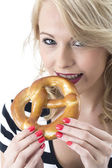 Young Woman Eating a Pretzel — Stock Photo