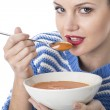 Young Woman Eating Tomato Soup — Stock Photo