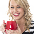 Attractive Young Woman Holding a Mug of Tea — Stock Photo