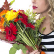 Attractive Young Woman Holding a Bunch of Flowers — Stock Photo