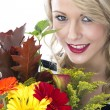 Attractive Young Woman Holding a Bunch of Flowers — Stock Photo #32634647