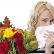 Attractive Young Woman with Hayfever Holding a Bunch of Flowers — Stock Photo