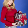 Attractive Young Woman Holding Christmas Present — Stock Photo