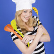 Young Woman in Chefs Hat Holding Kitchen Utensils — Stock Photo #34128409