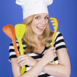 Young Woman in Chefs Hat Holding Kitchen Utensils — Stock Photo #34128467