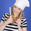 Young Woman in Chefs Hat Holding Kitchen Utensils — Stock Photo #34128905