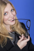 Attractive Young Business Woman Playing with Spectacles — Stock Photo