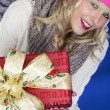 Young Woman Carrying Christmas Presents — Stock Photo