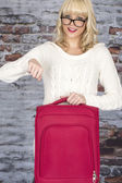 Attractive Young Woman Holding a Suitcase — Stock Photo