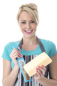 Young Woman Grating Cheese — Stock Photo