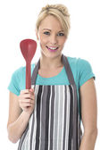 Young Woman Holding Plastic Serving Spoons — Stock Photo