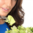 Stock Photo: Young WomEating Green Salad