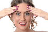Young Woman Massaging Face — Stock Photo