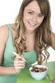 Attractive Young Woman Eating Breakfast Cereals — Stock Photo
