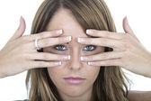 Sad Young Woman Peering Through Fingers — Stock Photo
