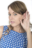 Young Woman Wearing Blue Polka Dot Dress Eavesdropping — Stock Photo