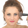 Young Woman Applying Face Powder — Stock Photo #45497135