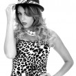 Young Woman Wearing Leopard Print Top and Hat — Stock Photo #49942615
