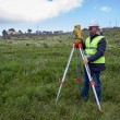 Engineer with theodolite - Stock Photo
