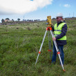 Engineer with theodolite — Stock Photo #20874799
