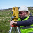 Engineer with theodolite — Stock Photo #20875359