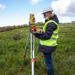 Engineer with theodolite — Stock Photo #20875965